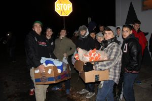 Union wrestlers bring warmth, food to homeless